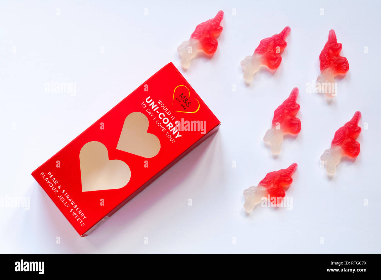 Box of M&S would it be uni-corny to say I love you pear & strawberry flavour jelly sweets opened to show contents on white - for Valentines Day - Stock Image