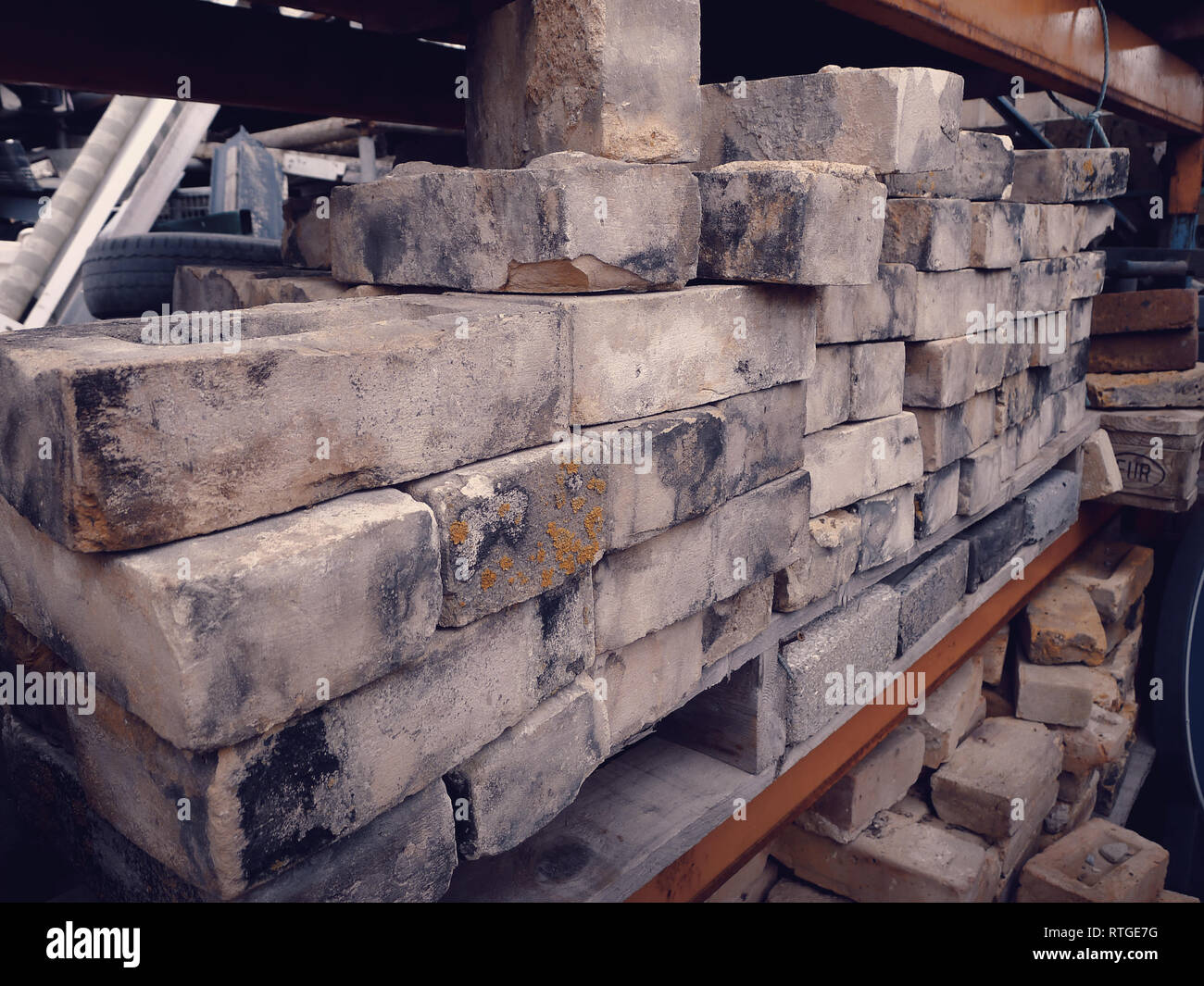 Close up of soft yellow bricks at a salvage yard in the UK Stock