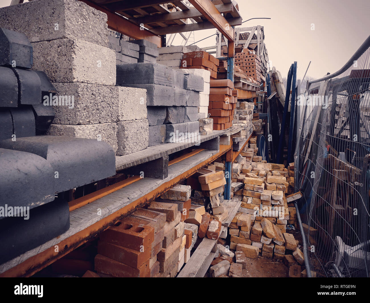 Stacks of various reclaimed bricks at a salvage yard in the