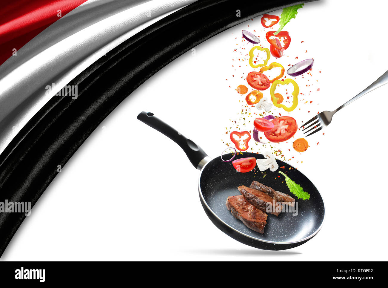 Frying pan with falling vegetables and meat, isolated. On the background of the flag of Yemen - Stock Image