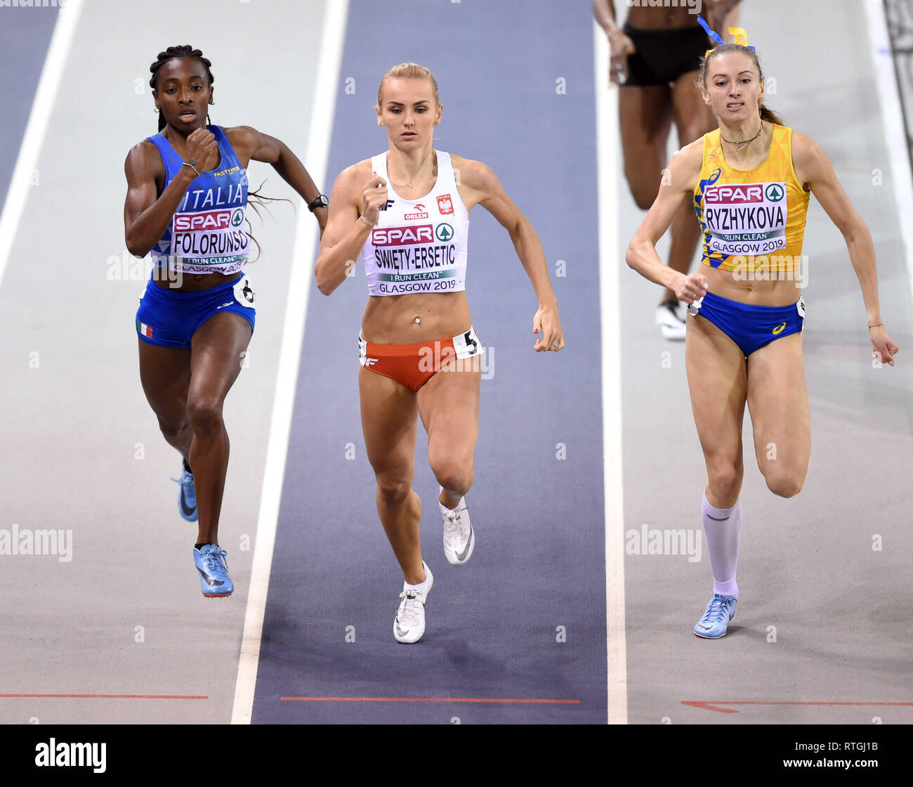 (From left to right) Italy's Ayomide Folorunso, Poland's Justyna Swiety-Ersetic and Ukraine's Anna Ryzhykova competing in the Women's 400m heat 4 during day one of the European Indoor Athletics Championships at the Emirates Arena, Glasgow. - Stock Image