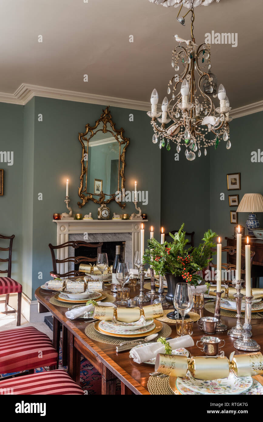 Mahogany Dining Table With Chairs Upholstered In Regency Stripe With English Fireplace Stock Photo Alamy