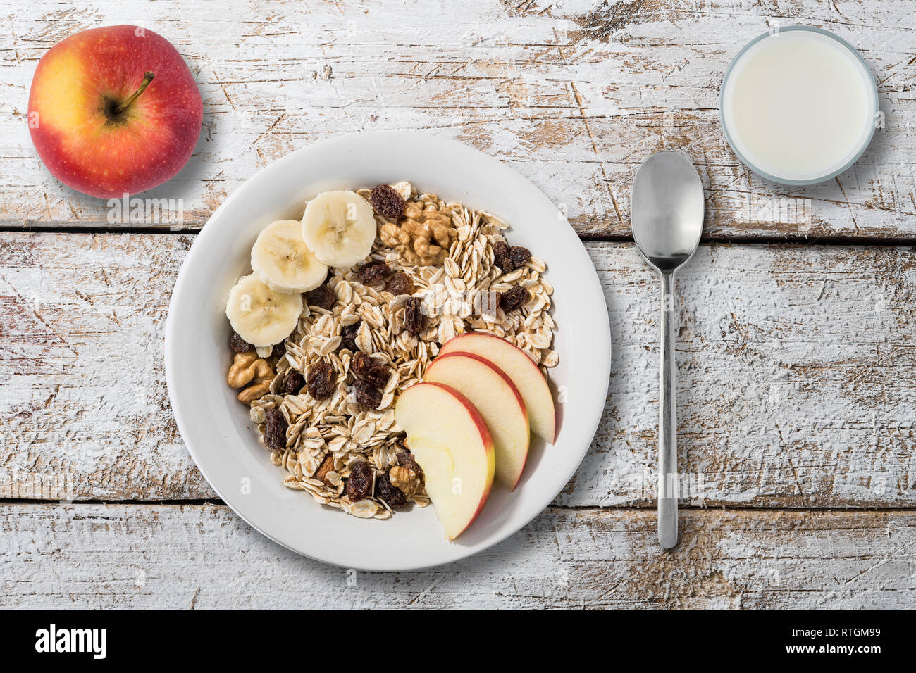 white plate with oat flakes on an old wooden table Stock Photo