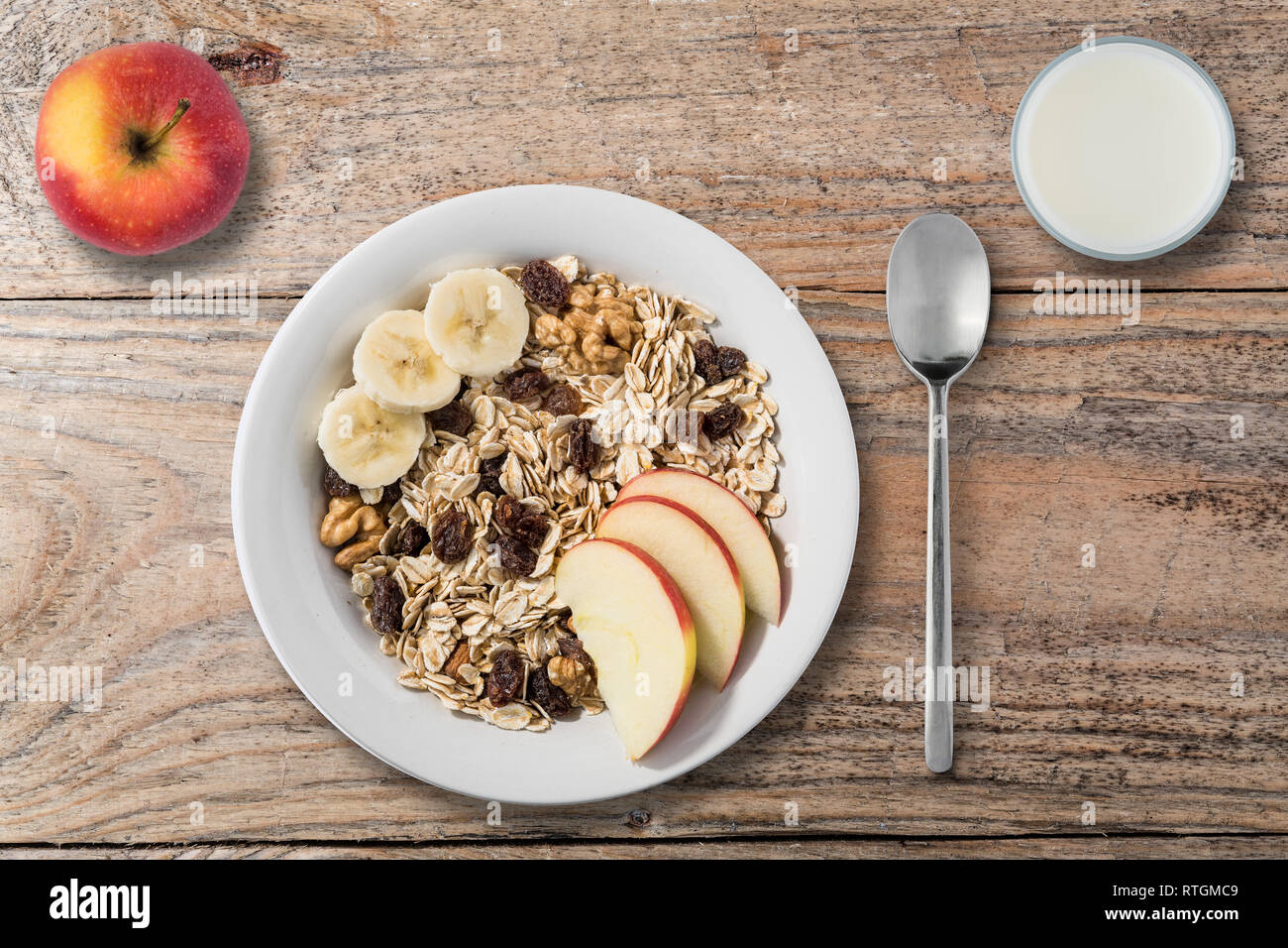 white plate with oat flakes on old wooden table Stock Photo