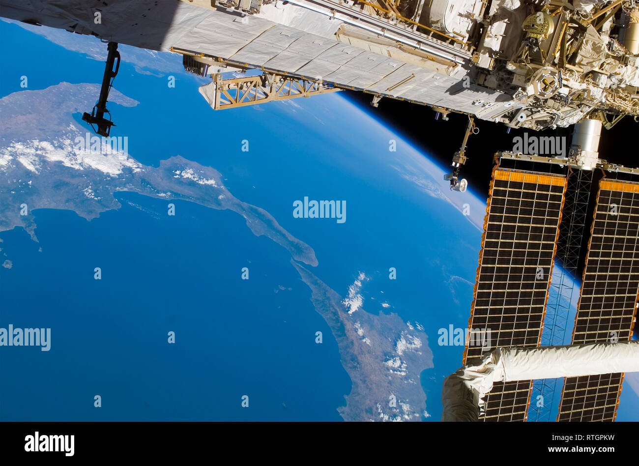 The International Space Station frames this view of thand the boot of Italy plus Siciily - Stock Image