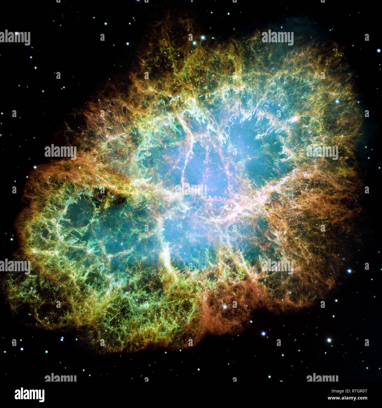 The Crab Nebula is one of the most intricately structured and highly  dynamical objects ever observed. The new Hubble image of the Crab was  assembled - Stock Image