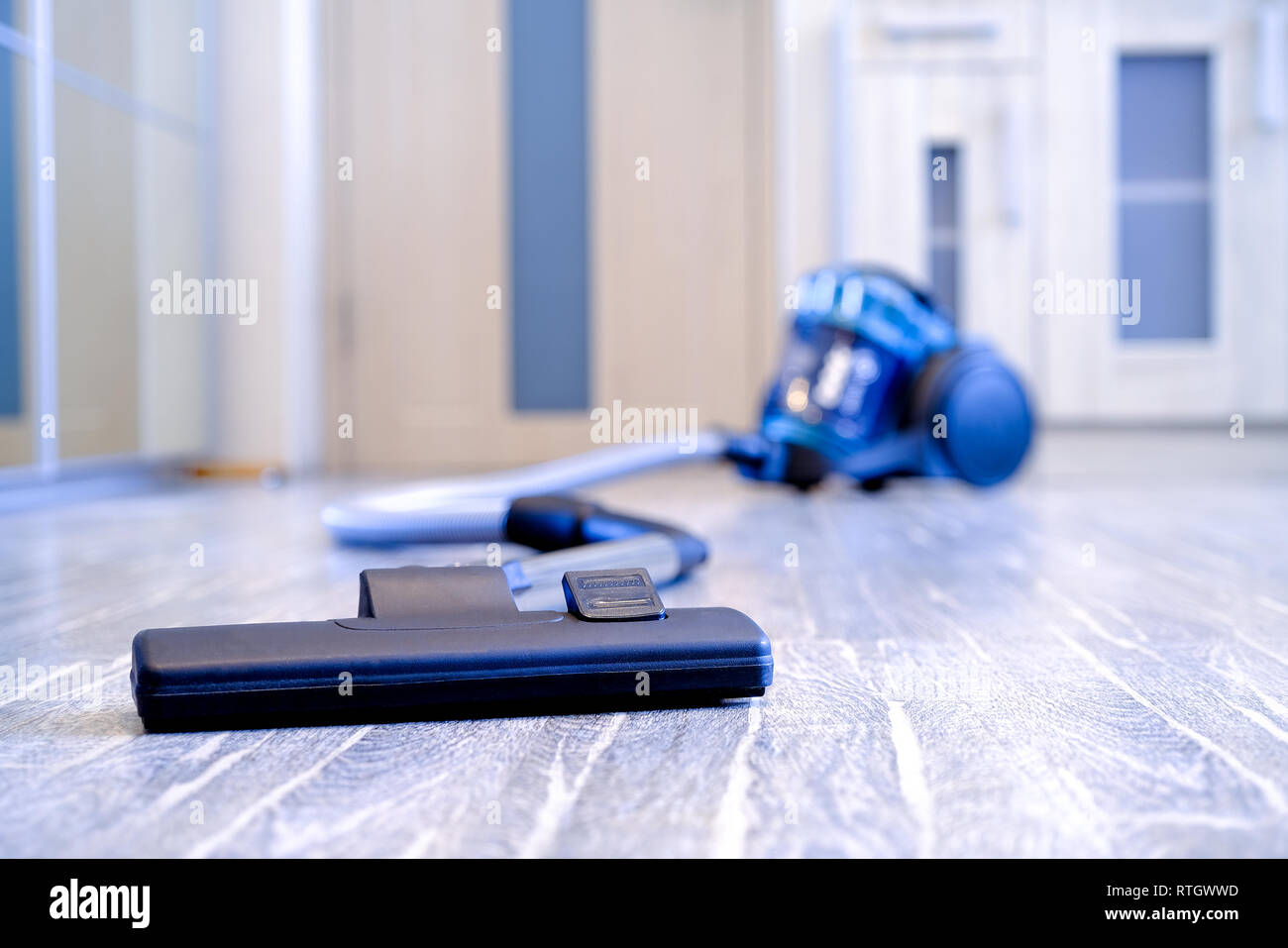 Household appliances, vacuum cleaner. The concept of cleanliness and order in the premises - Stock Image