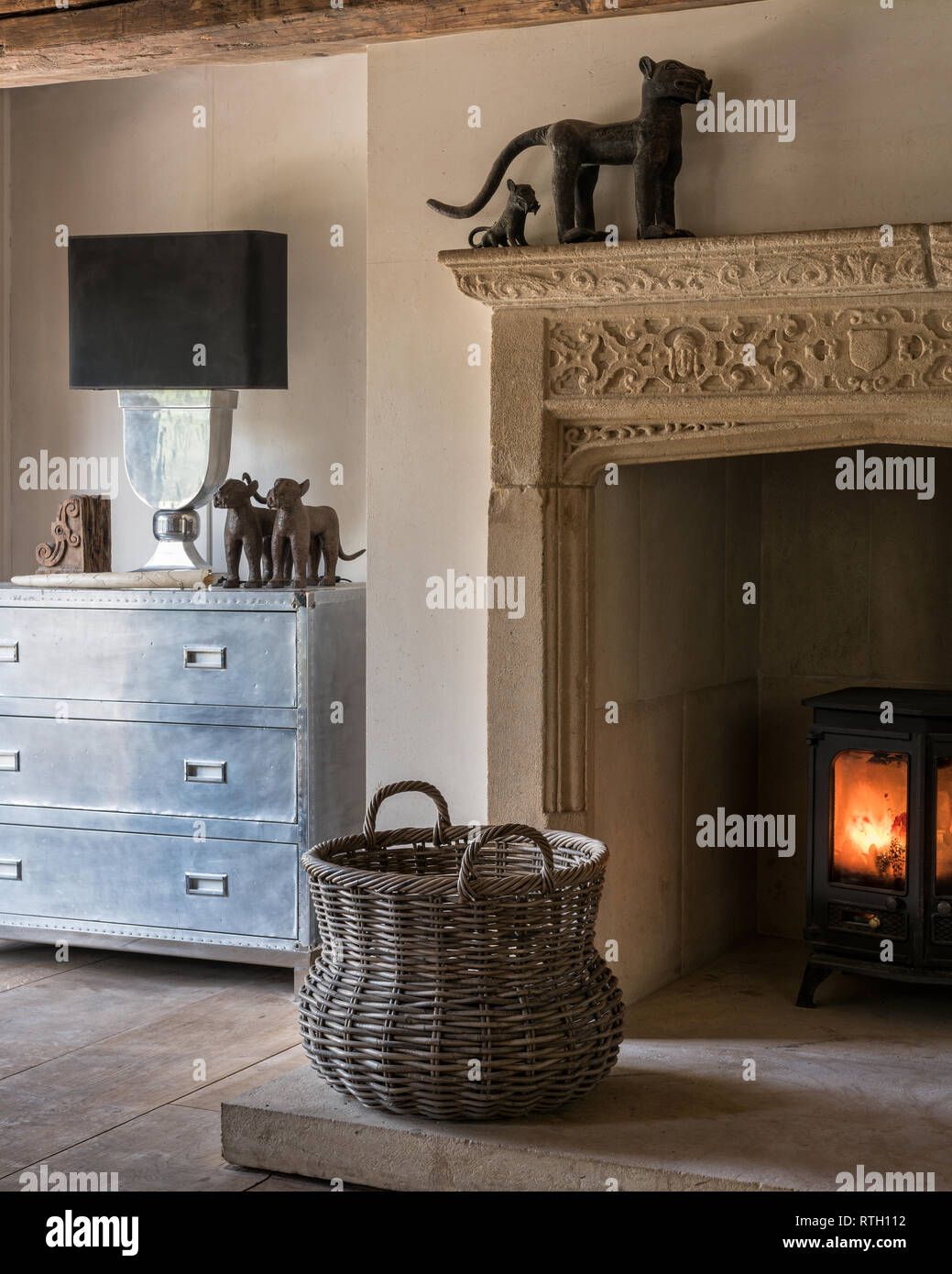 Decorative medieval fireplace with aluminium chest - Stock Image