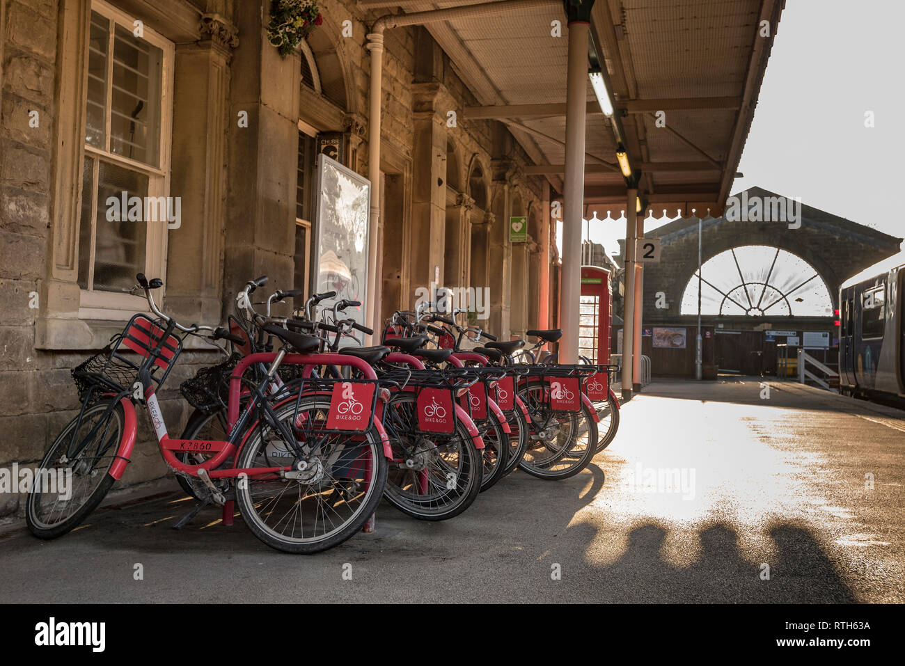 Buxton railway station. sunset Bike and Go cycles - Stock Image
