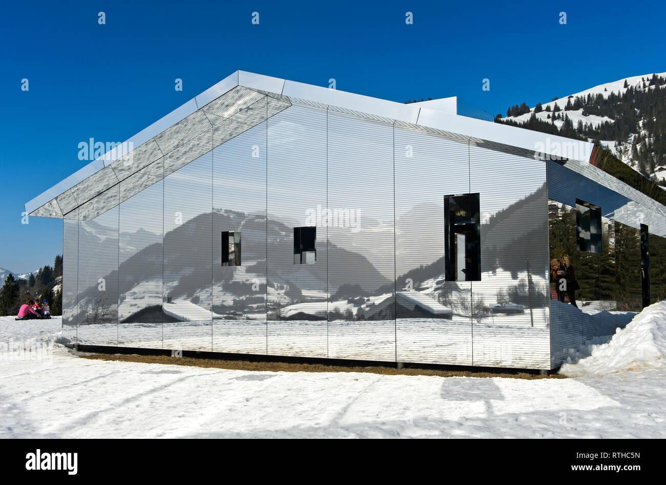 Mirror house Mirage Gstaad by Doug Aitken, Art Exhibition Elevation 1049: Frequencies, Gstaad, Switzerland - Stock Image
