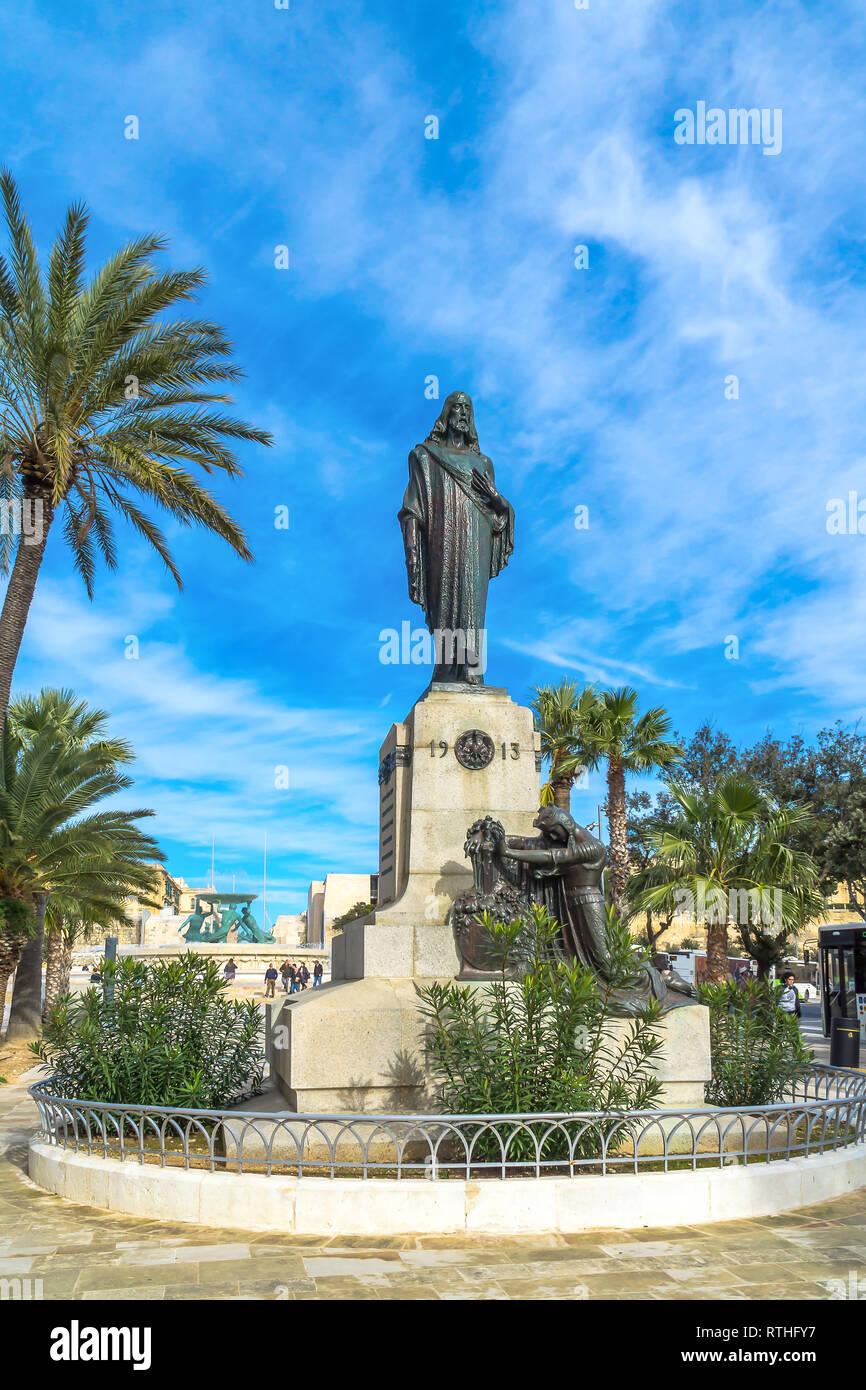 The statue of Cristo Re or Christ of King by Antonio Scortino to commemorate the International Eucharistic Congress of 1913 - Floriana, Malta. - Stock Image