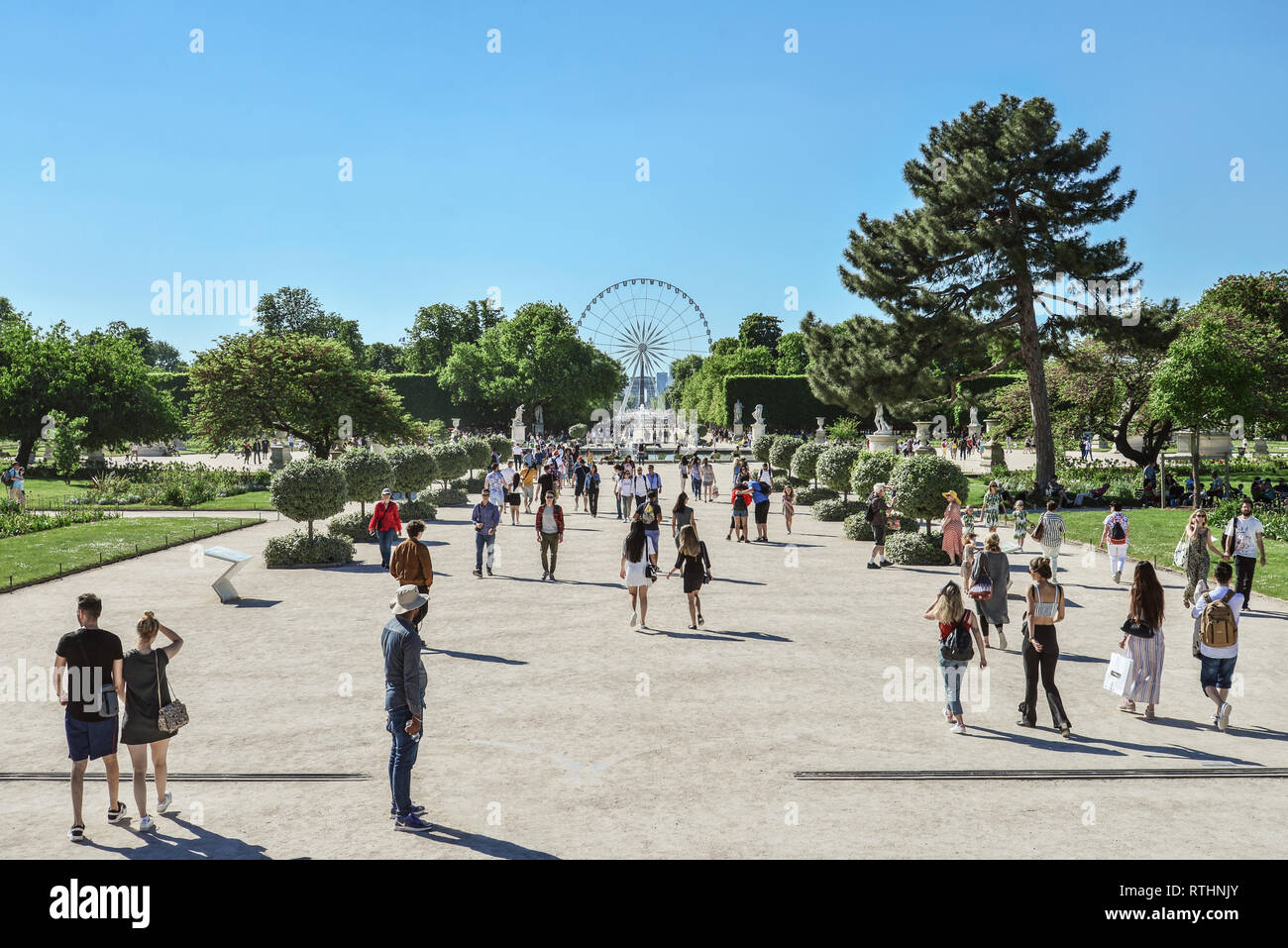 Paris, France - May 7, 2018:  Jardin des Tuileries (Tuileries garden) - favorite spot for rest of tourists and Parisians. Garden was created by Cather - Stock Image