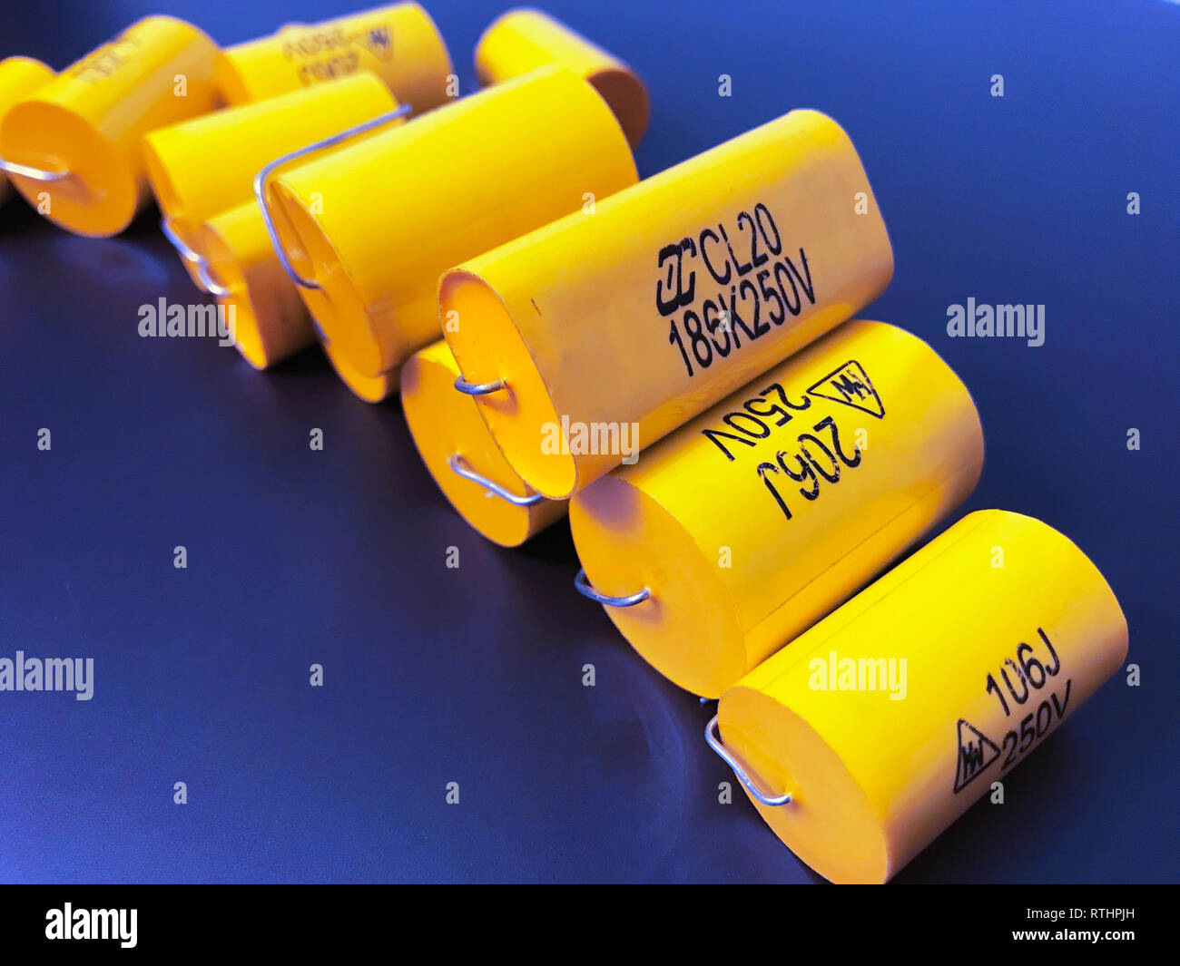 Group of audiophile metal-film axial capacitors different sizes. - Stock Image