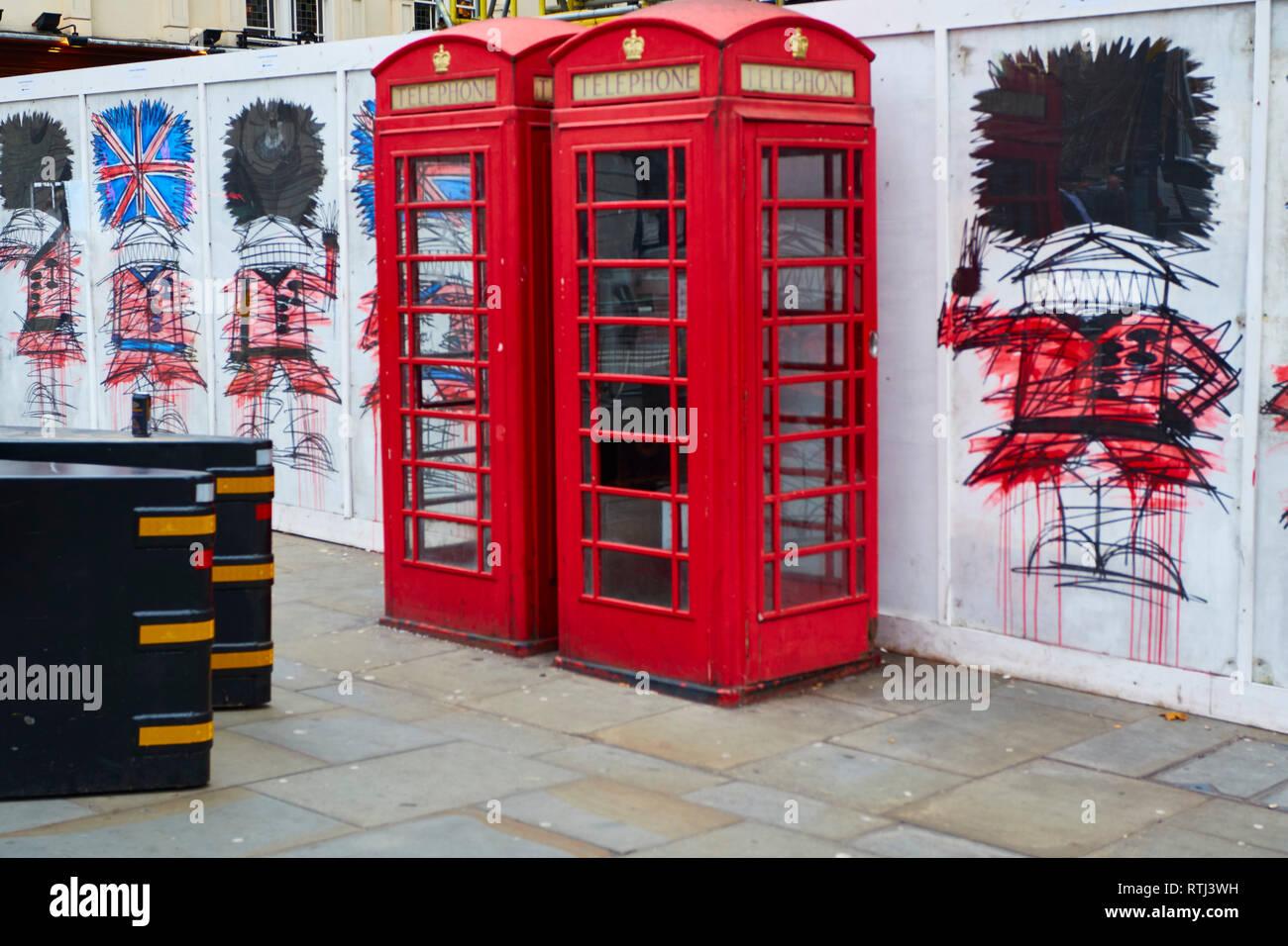 Red telephone boxes in swinging London, England, United Kingdom, Europe - Stock Image