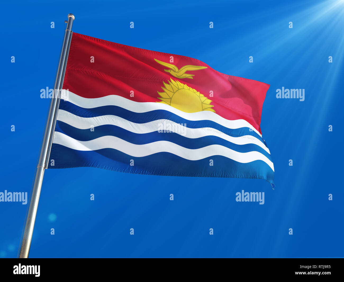Kiribati National Flag Waving on pole against deep blue sky background. High Definition - Stock Image