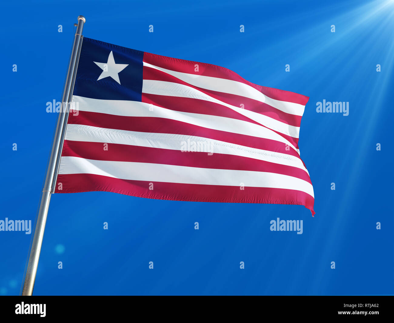 Liberia National Flag Waving on pole against deep blue sky background. High Definition - Stock Image