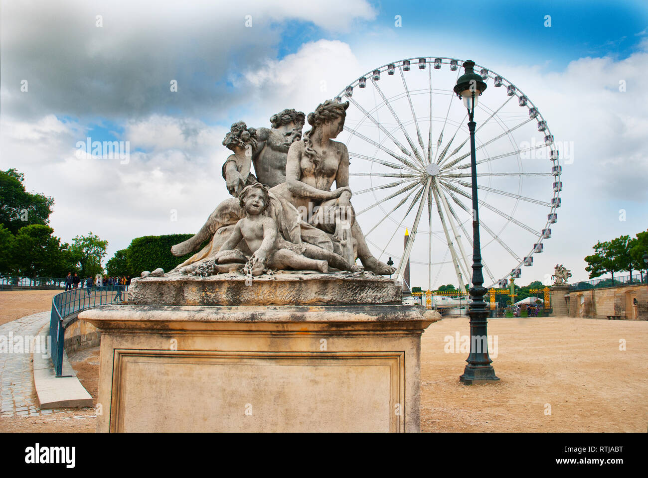 Classic statue  with Ferris wheel in background, Tuileries Garden, Paris, France - Stock Image