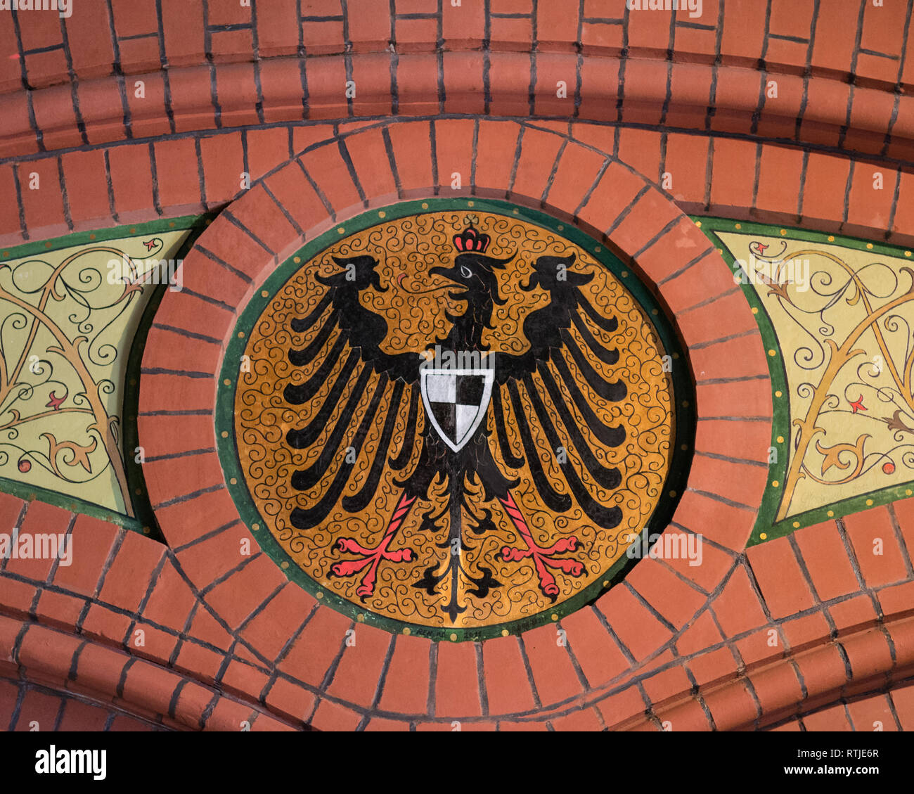 Prussian Coat of Arms with the black Prussian Eagle at Malbork Train station, Poland, Europe - Stock Image