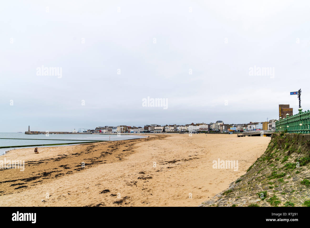 Landscape of Margate seafront with the main sands, harbour, Turner Center art gallery and seafront buildings including Dreamland. Grey overcast sky. - Stock Image
