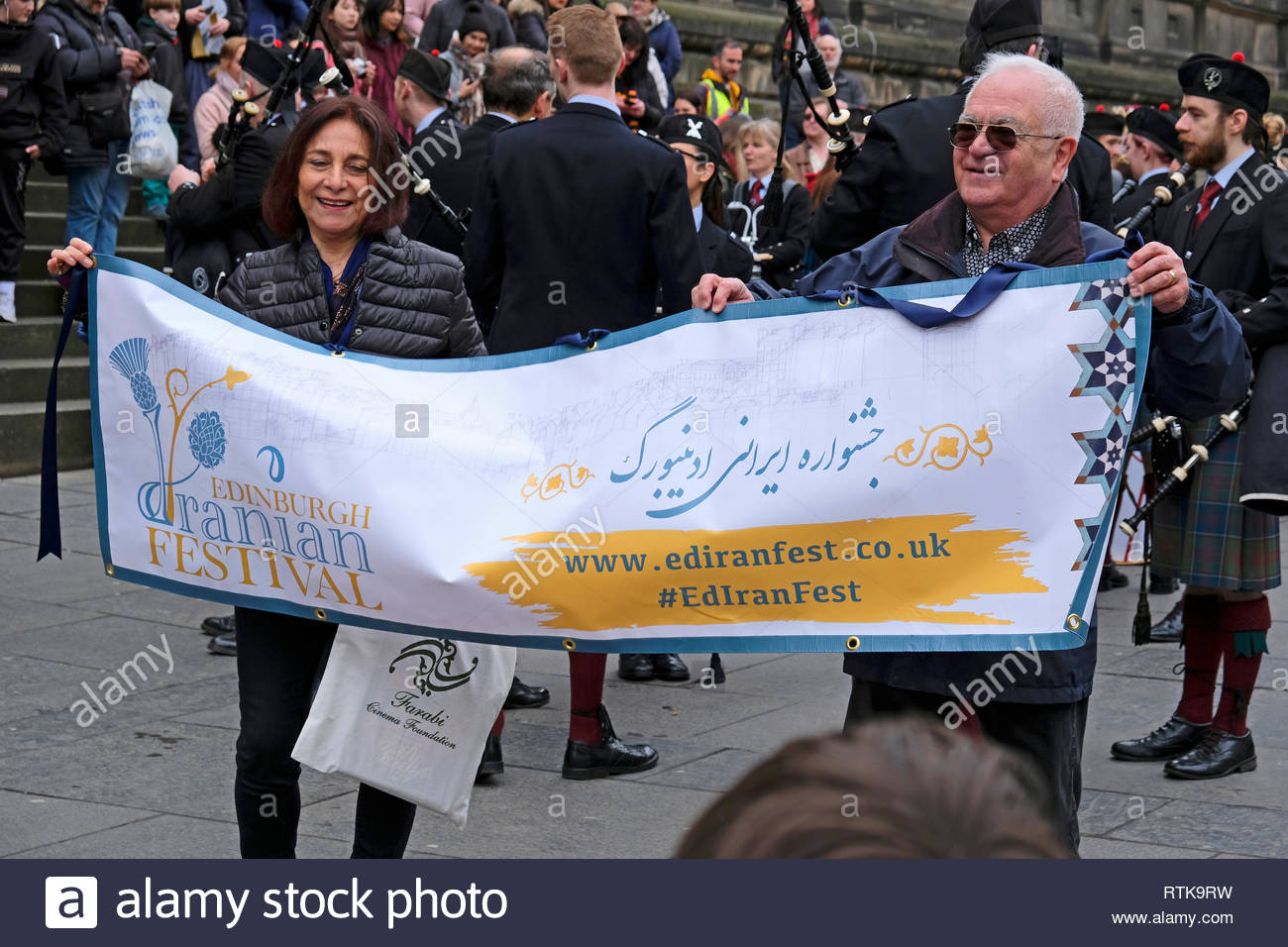 Edinburgh, United Kingdom. 2nd March 2019.  Iranian and Scottish Bagpipe parade outside the National Museum of Scotland, part of the Edinburgh Iranian festival, celebrating Iranian culture and integrating communities.  Credit: Craig Brown/Alamy Live News - Stock Image