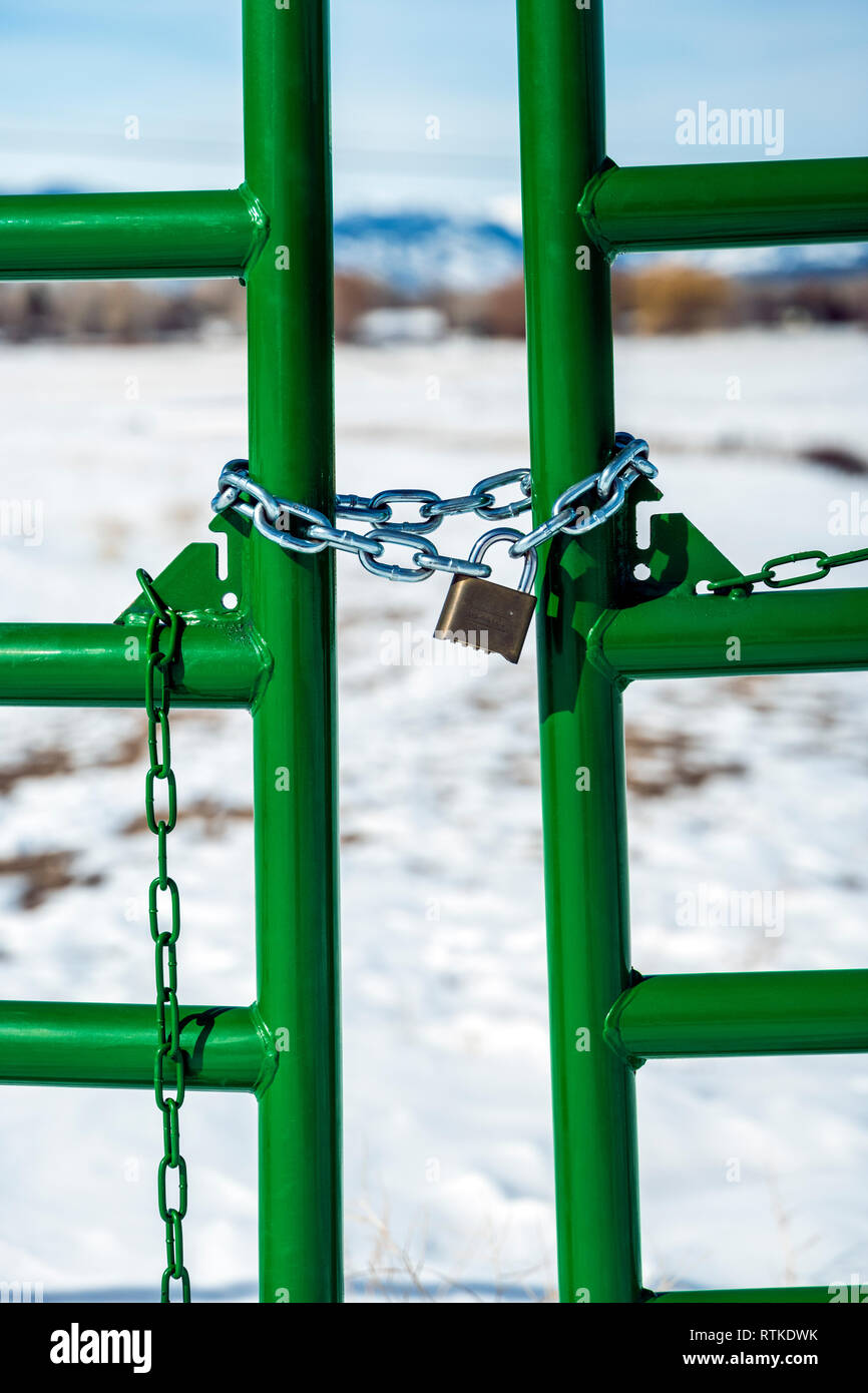 Ranch gate locked with padlock & chain; central Colorado; USA - Stock Image