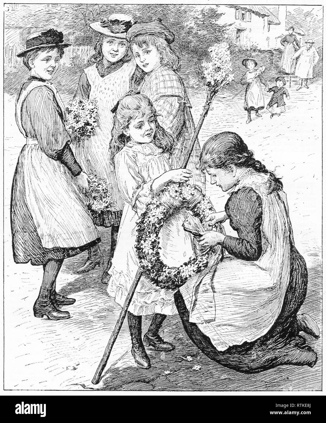 Engraving of a mother adjusting a wreath for her daughter as she goes to a May Day festival. From Chatterbox magazine, 1905 - Stock Image