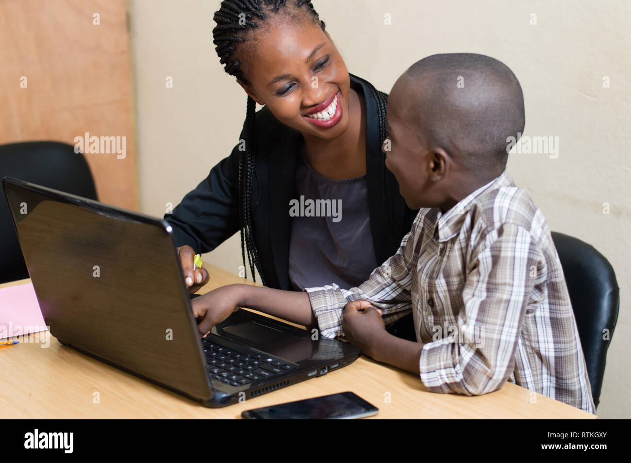 The very happy child, laughs loudly with his mistress. - Stock Image