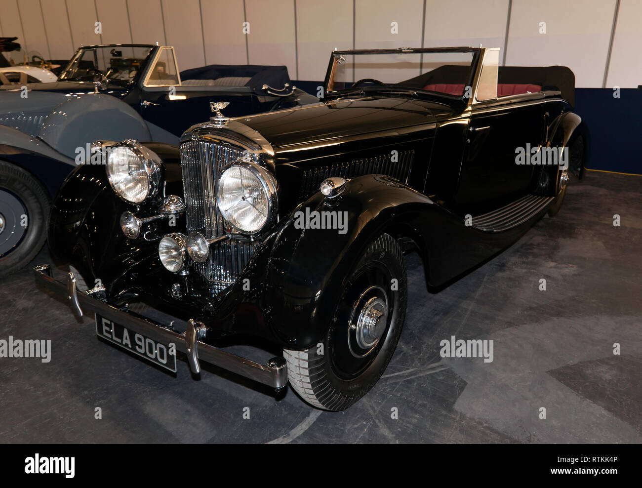 Three-quarters Front-view of a Black,1937 Bentley 4.5L 2-Door Drophead Coupe on display in the Paddock Area of the 2019 London Classic Car Show - Stock Image