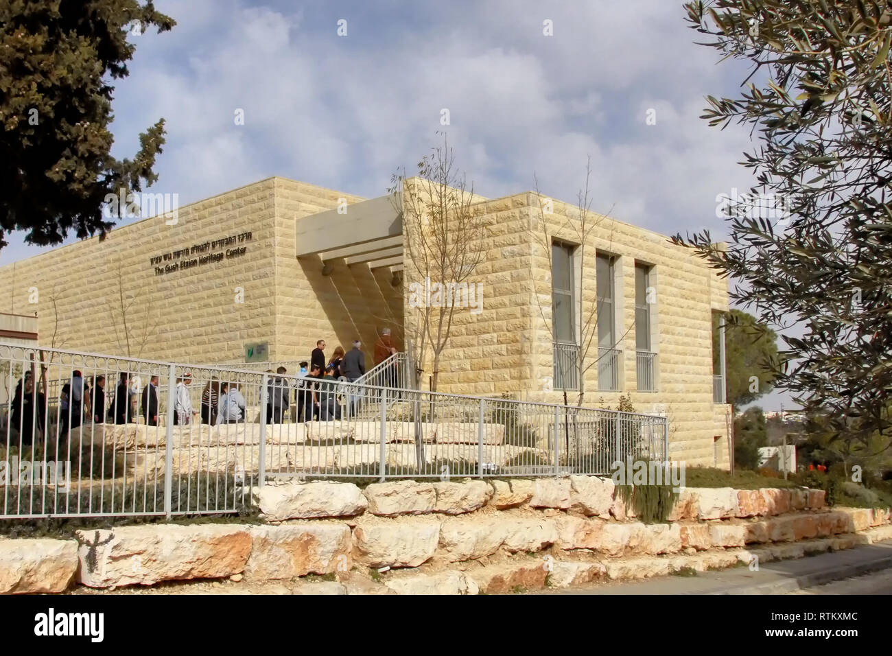 A group of people enter the Gush Etzion Heritage Center in Kfar Etzion, Israel. - Stock Image