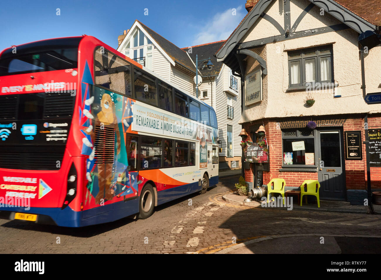 Colourful Canterbury bus driving through Whitstable street, Kent, England, United Kingdom - Stock Image