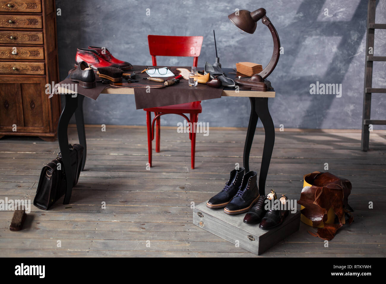 empty shoemaker's work table . messy desk with necessary tools for repair shoes - Stock Image