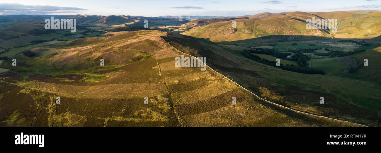 Aerial image showing Glenholm and the Upper Tweed Valley with the hills Drumelzier Law and Logan Head. - Stock Image