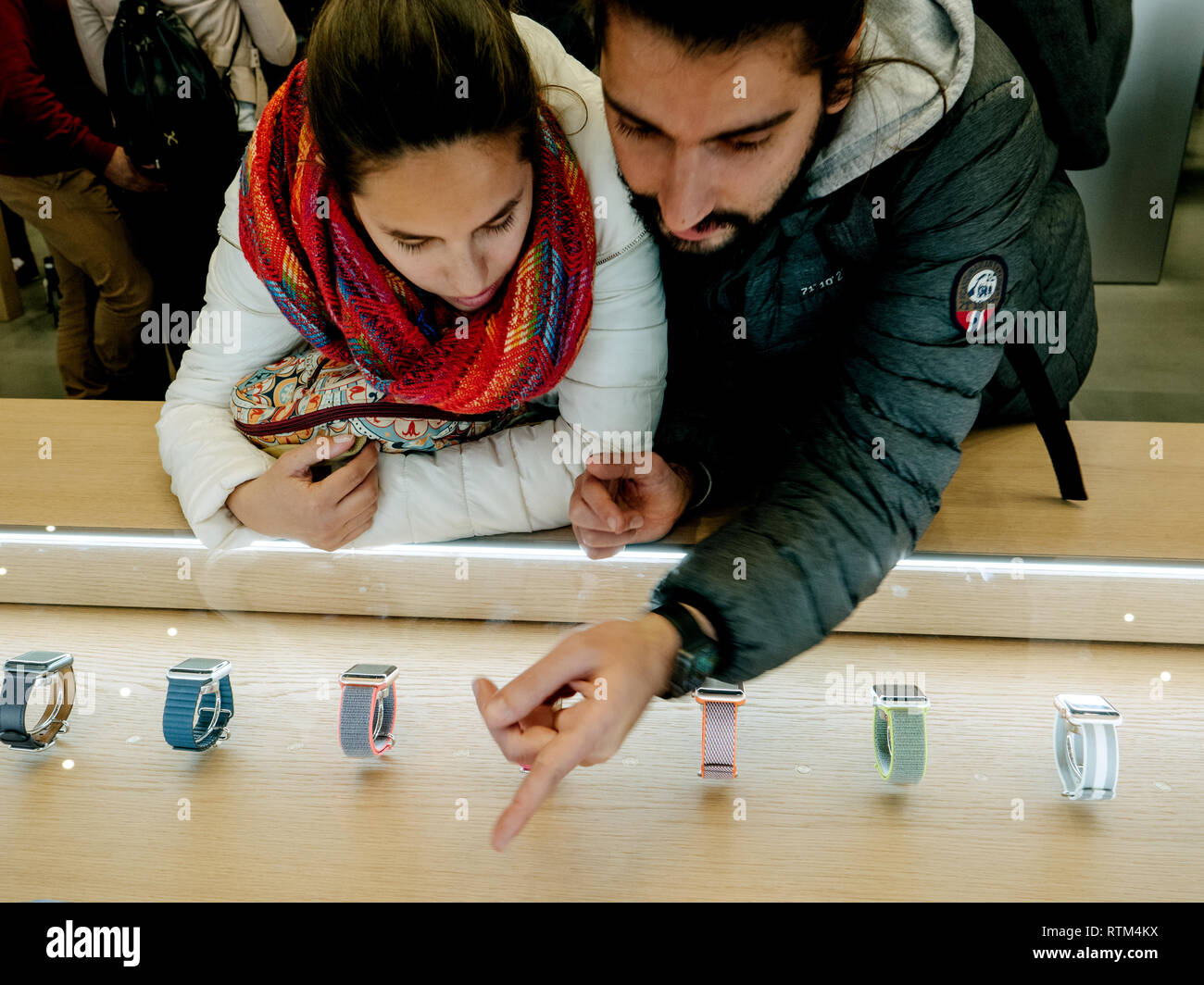 BARCELONA, SPAIN - NOV 13, 2017: Young spanish couple selecting the latest Apple Watch Series 3 wirst in the Apple Store Stock Photo