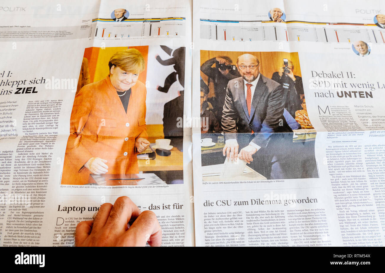 PARIS, FRANCE - SEP 25, 2017: International newspaper with portrait of Angela Merkel and Martin Schulz after voting - election in Germany for the Chancellor of Germany, the head of the federal government - Stock Image