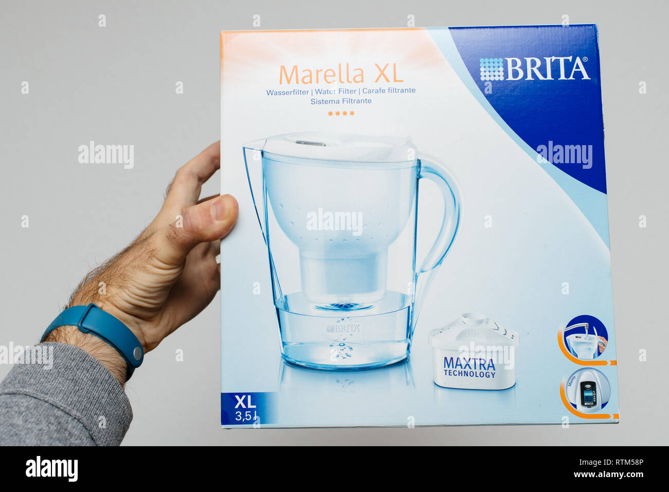 PARIS, FRANCE - DEC 18, 2017: Man holding New Brita Marella XL water filter against white background - Stock Image