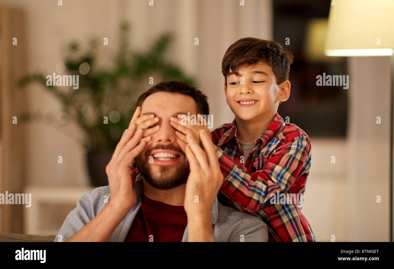 happy father and little son playing at home - Stock Image