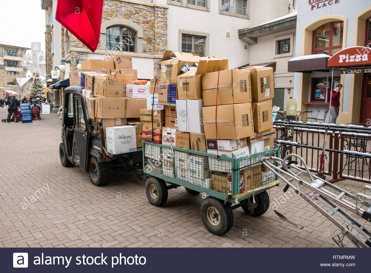 Trailer stacked high with various cardboard boxes behind a