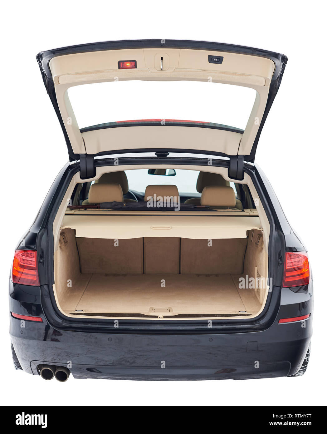 Wide open modern car trunk isolated on white background - Stock Image
