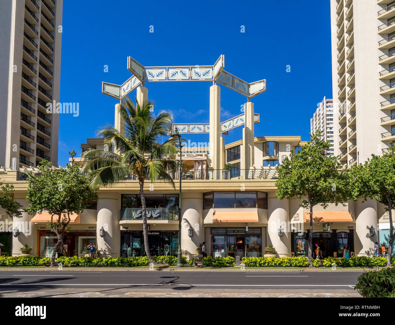 Retail outlets on Kalakaua Avenue on August 5, 2016 in Waikiki, Hawaii. Kalakaua Avenue is the favorite luxury shopping strip for tourists visiting Ha - Stock Image