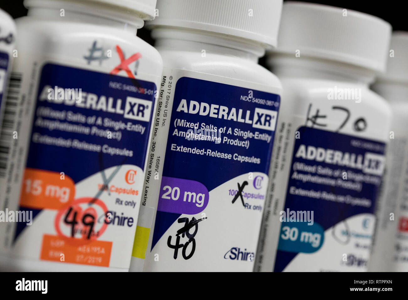 Bottles of Adderall XR prescription pharmaceuticals photographed in a pharmacy. - Stock Image