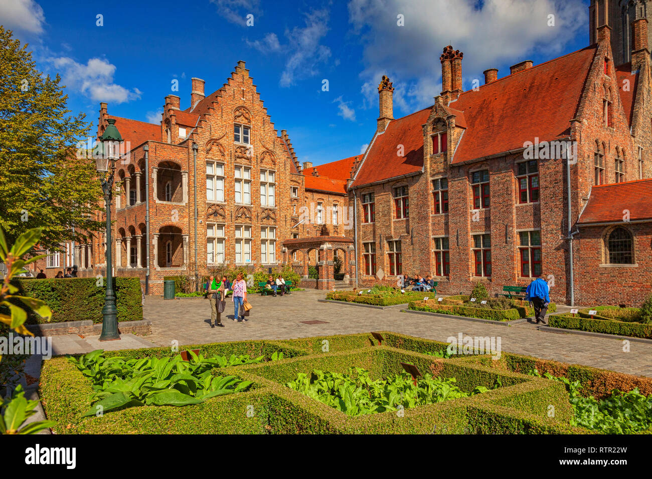 25 September 2018: Bruges, Belgium - People strolling in the courtyard of the medieval St John's Hospital in Bruges, Belgium, on a glorious autumn day Stock Photo