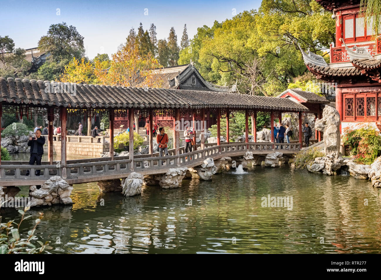 29 November 2018: Shanghai, China - The Jade Water Corridor bridge across a lake in the Yu Garden, part of the Shanghai Old Town district. - Stock Image