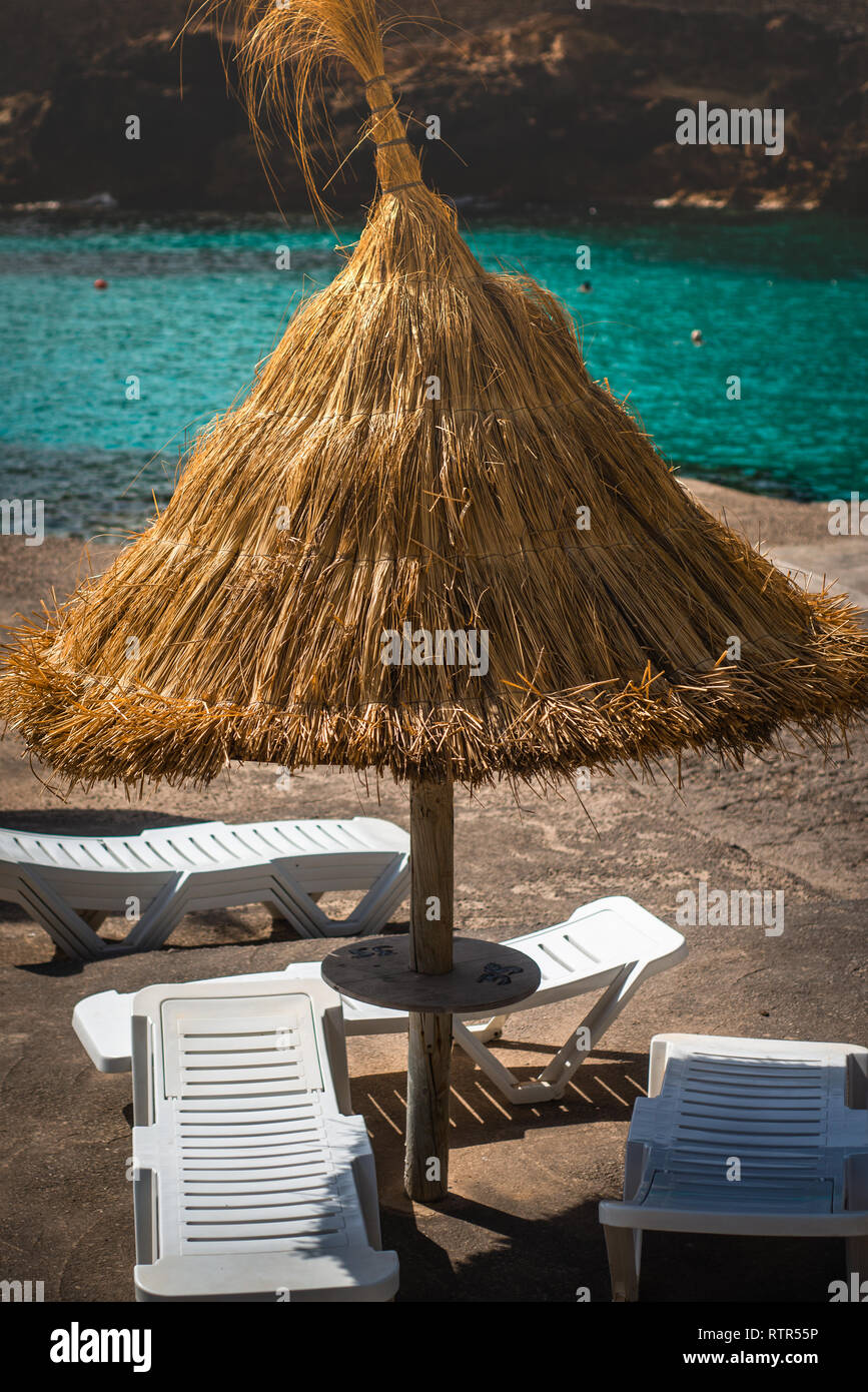 Sun Shade and Loungers At a Beach Bar, Mallorca, Balearic Islands - Stock Image