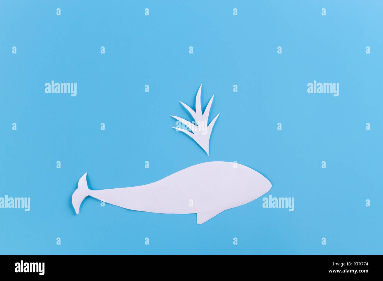 whale in the ocean. paper cut on blue background Stock Photo