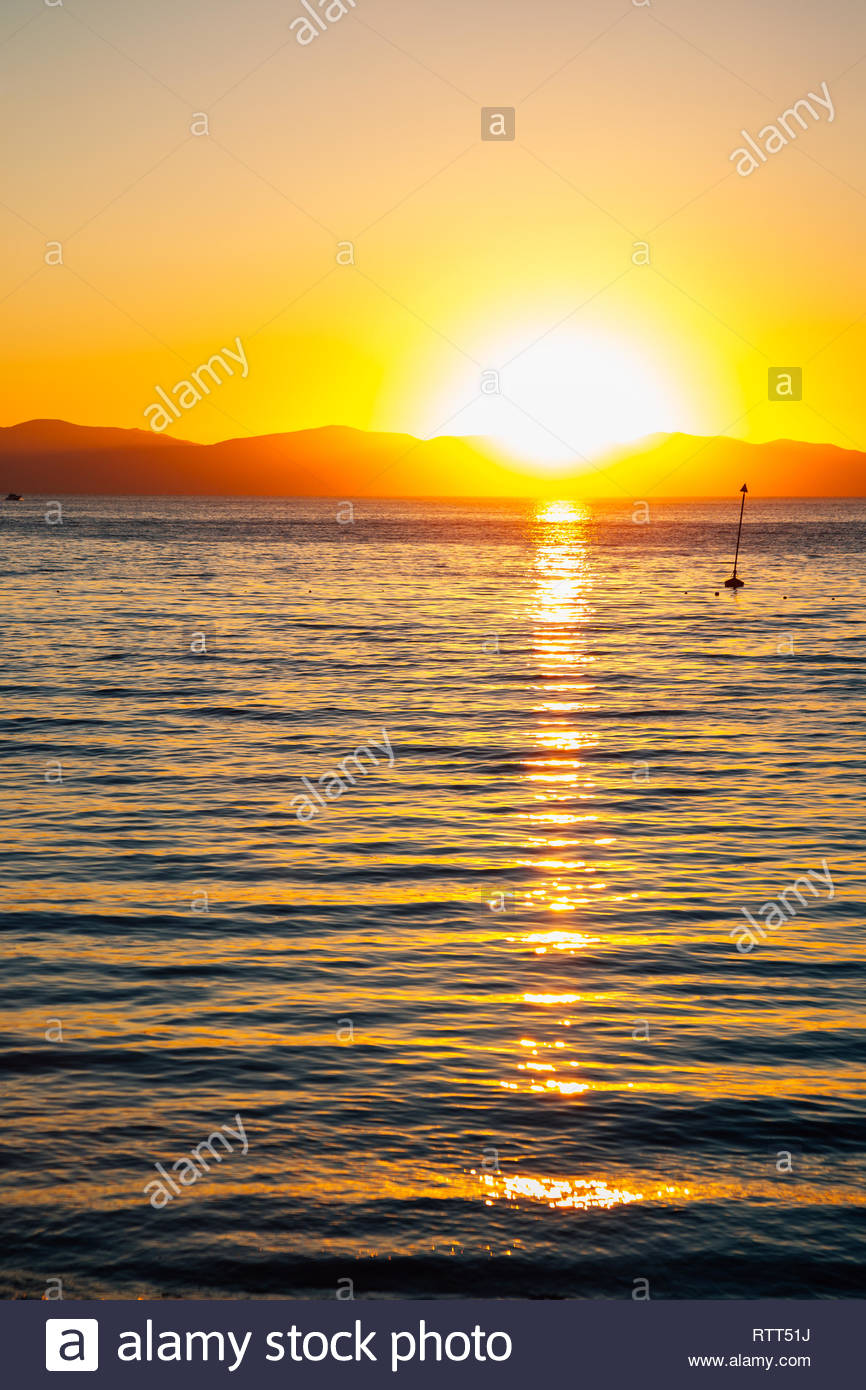 Sunset beach and water wave in Vladivostok, Russia - Stock Image