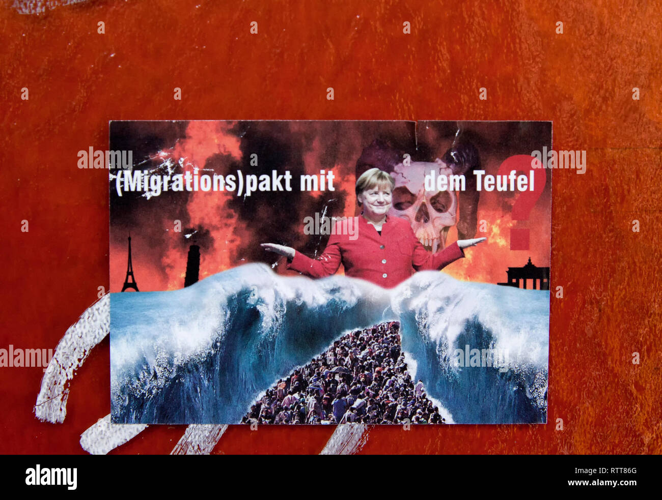 Sticker, migration pact with the devil, Angela Merkel, Berlin, Germany - Stock Image