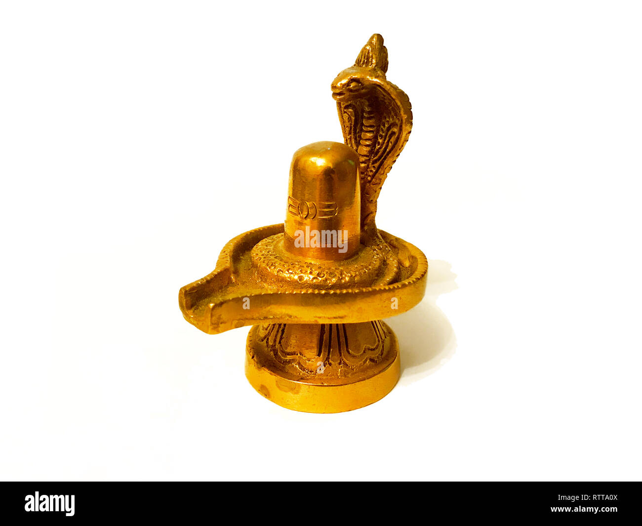 Gold Lord Shiva Lingam sculpture isolated on white background - Stock Image