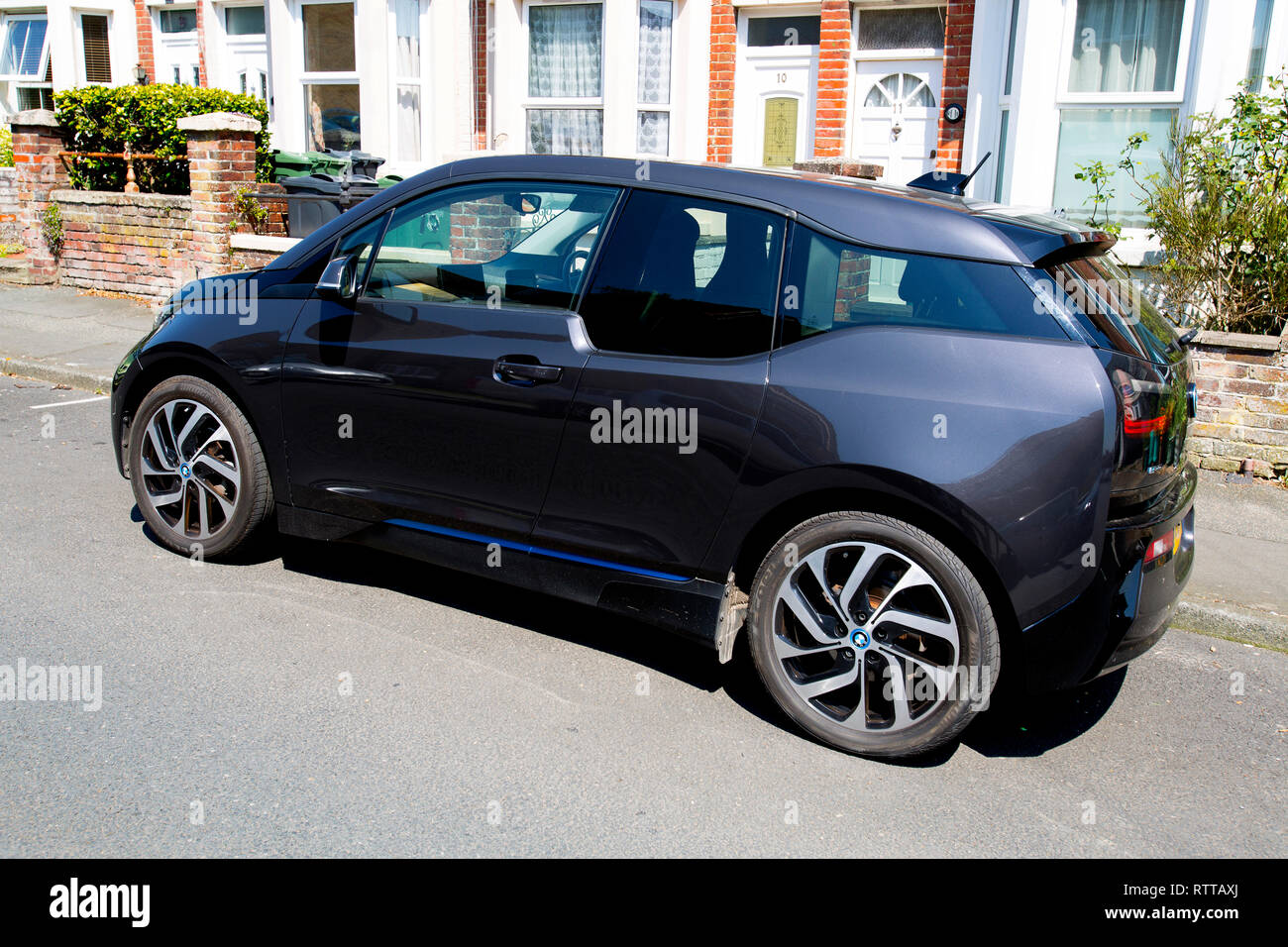 BMW, electric, car, EV, parked, England, road, charge, Cowes,Isle of Wight, UK, - Stock Image