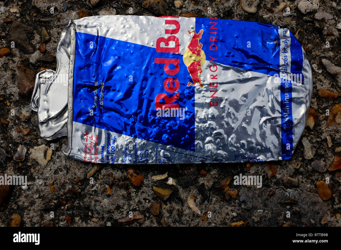 flattened, RedBull, Red,Bull, can, on,the,road, tin, drink, energy, caffine, sugar, blue, silver, - Stock Image