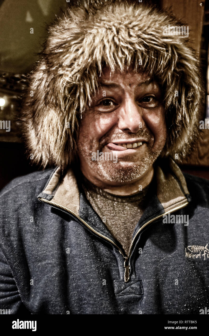 photographer Patrick Eden wearing furry hat,pulling silly,stupid face, model released, - Stock Image
